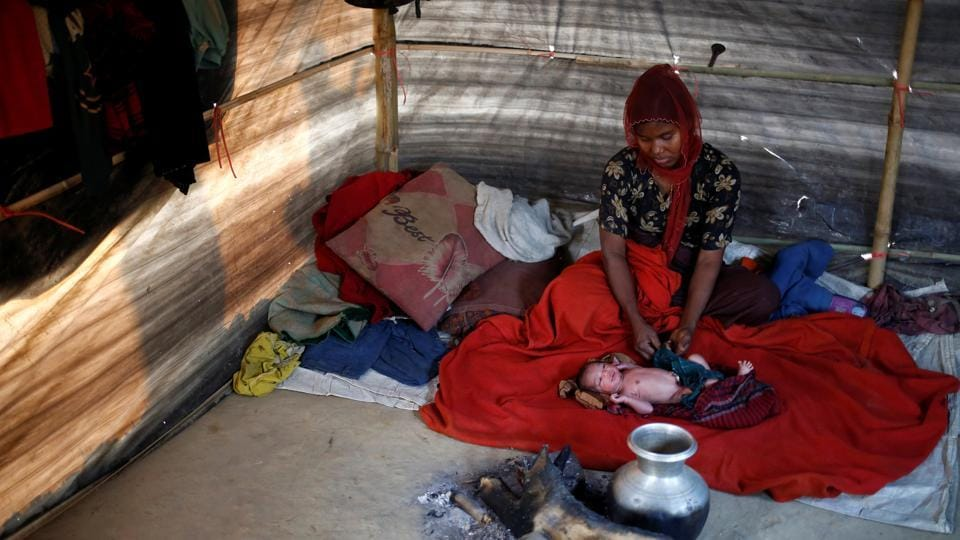 Rehana Begum, 25, sits near her one-day-old unnamed daughter inside their shelter at Kutupalang unregistered refugee camp in Cox's Bazar. 'We were in our home and suddenly the military came to our village and started shooting,
