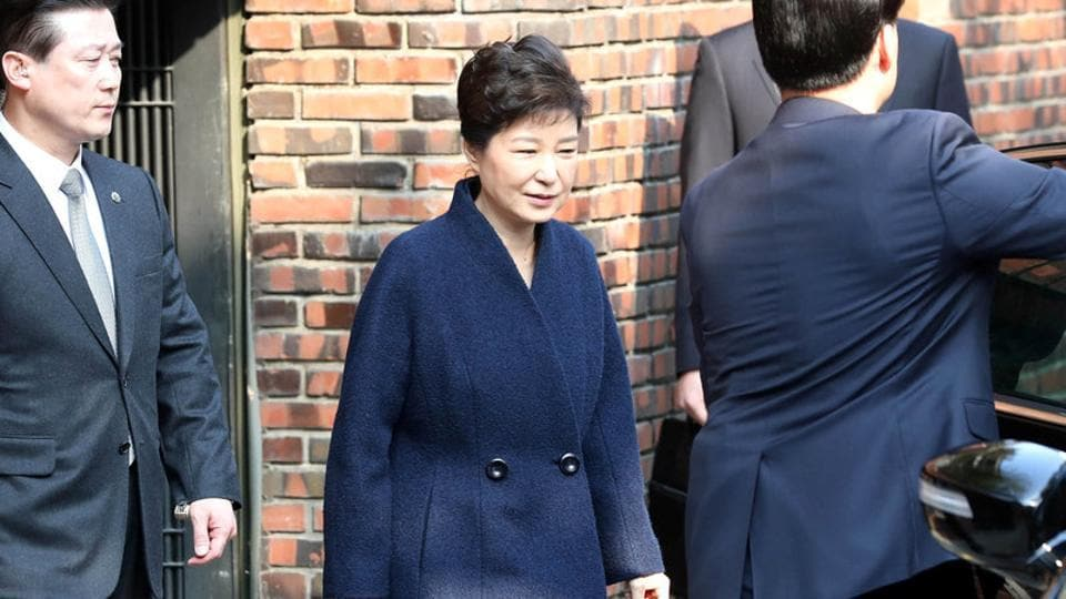 South Korea's ousted leader Park Geun-hye leaves from her private home as she heads to the prosecutors' office to be questioned over a widening corruption scandal in Seoul, South Korea, March 21, 2017.