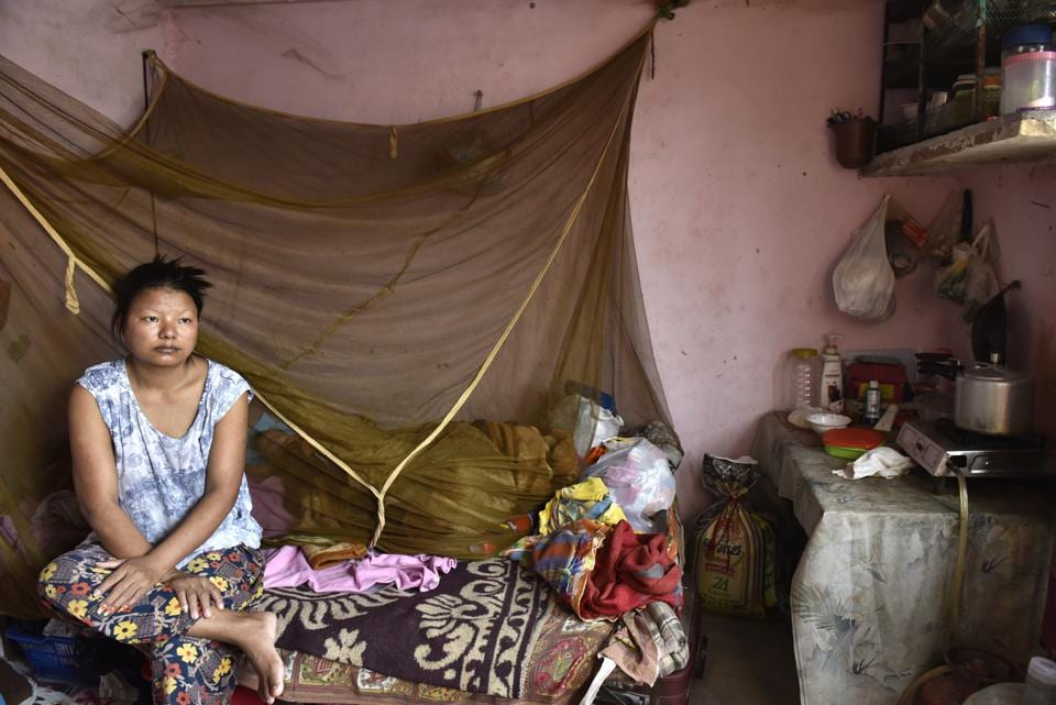 Khar's wife, Ngaideilum, wishes she had a job to support him and her five-year-old daughter. But for refugees, finding a job is difficult -- the only documentation they have is  a UNHCR card, so the only jobs they get are in the informal sector.  (Saumya Khandelwal/HT PHOTO)