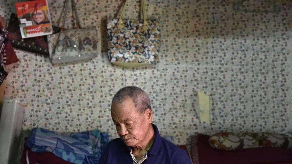 Bodella in west Delhi is home to about 4,000 Chin refugees from Myanmar. Lian Khawen, 77, who came to India in 2010 lives in a one-room house with his wife, son and daughter. He says he fled Burma after facing persecution at the hands of the military junta.  (Saumya Khandelwal/HT PHOTO)