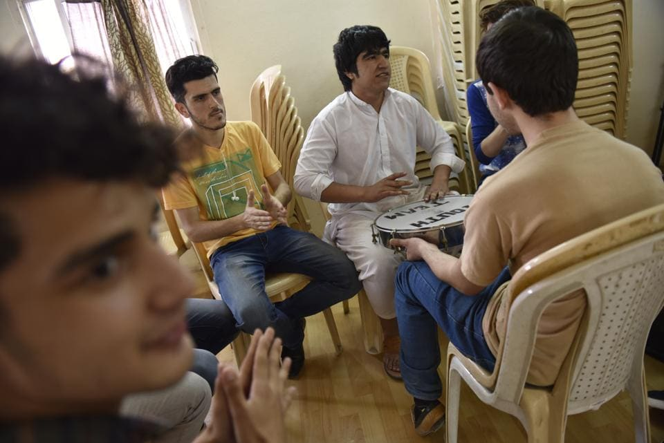 Refugee Assistant Centres run by UNHCR's partner organisations are trying to help refugees bridge the social handicap. At one such centre in Vikaspuri, a group of young refugees from Afghanistan sing songs.  (Saumya Khandelwal/HT PHOTO)