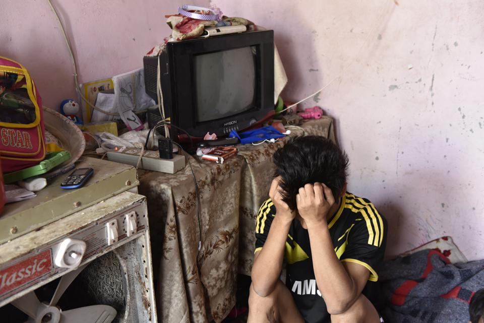 Joseph Khar, 32, who lives with his wife in a cramped room in a narrow lane in Bodella, suffers from Hepatitis-C. He is immobile and the family survives on a subsistence allowance of Rs 3,800 from UNHCR. (Saumya Khandelwal/HT PHOTO)