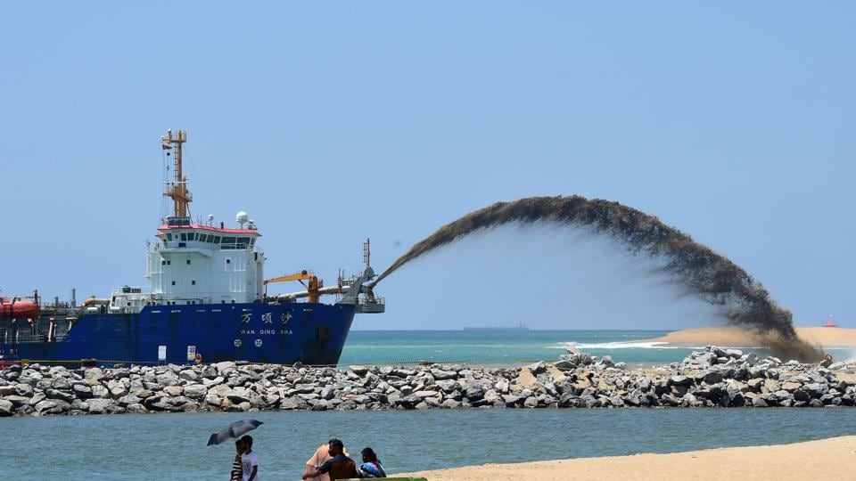 A dredger pumps sand to reclaim land outside the port of Colombo  as part of a $1.4-billion real estate development by China.