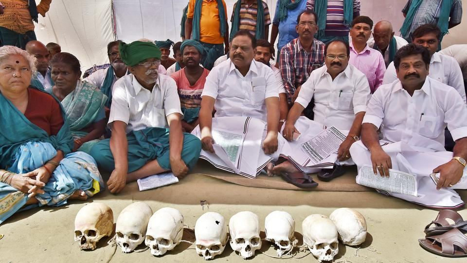 In a unique kind of protest, the farmers, all dressed in green lungis covered with leaves, are staging demonstration with dug-up skulls of fellow farmers who have committed suicide due to the drought. (Raj K Raj/HT PHOTO)