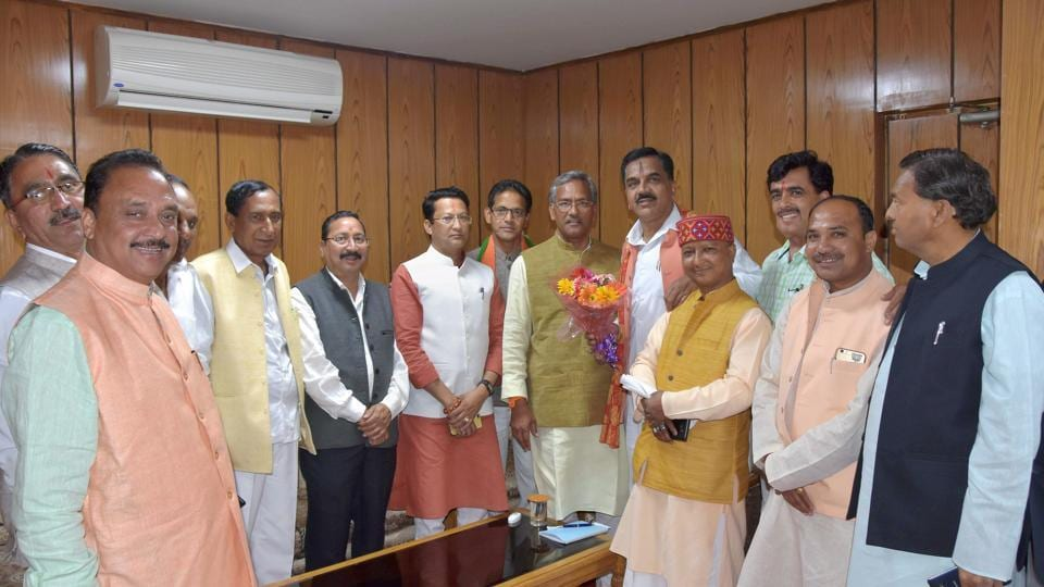 MLAs welcome chief minister Trivendra Singh Rawat after the oath taking ceremony at the assembly in Dehradun on Tuesday.