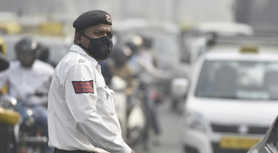 A Delhi Police personnel manages traffic at ITO.