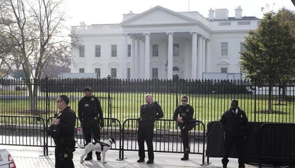 Secret Service agents patrol in front of the White House in Washington.