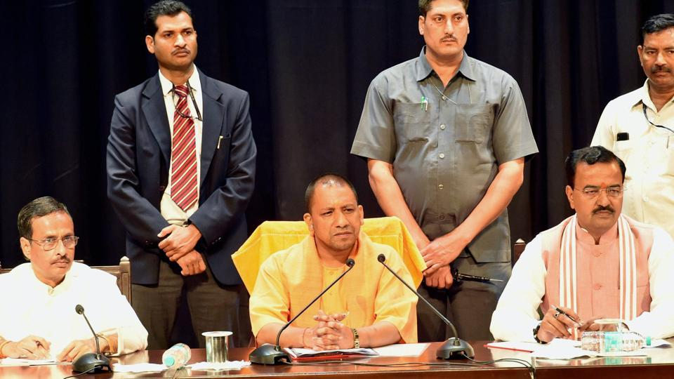 UP chief minister  Yogi Adityanath with deputy CMs Dinesh Sharma and Keshav Prasad Muriya at a meeting of police officers in Lucknow on March 20, 2017.
