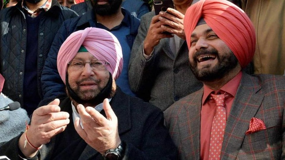 Punjab chief minister Capt Amarinder Singh with Navjot Singh Sidhu during a press conference in Amritsar