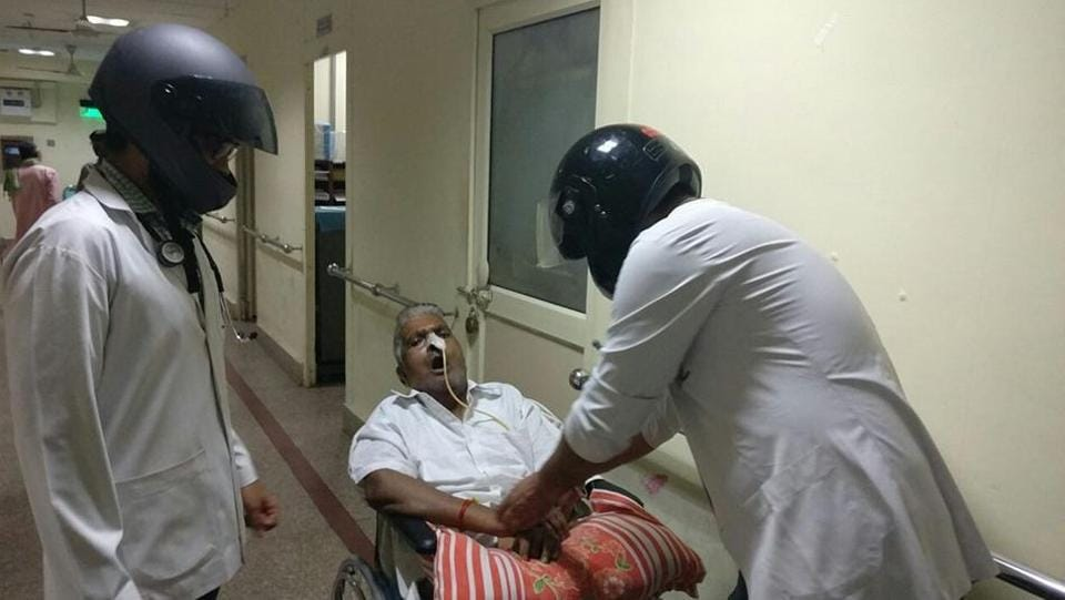 About 1,200 doctors at Delhi's All India Institute of Medical Sciences turned up for work on Wednesday wearing helmets.