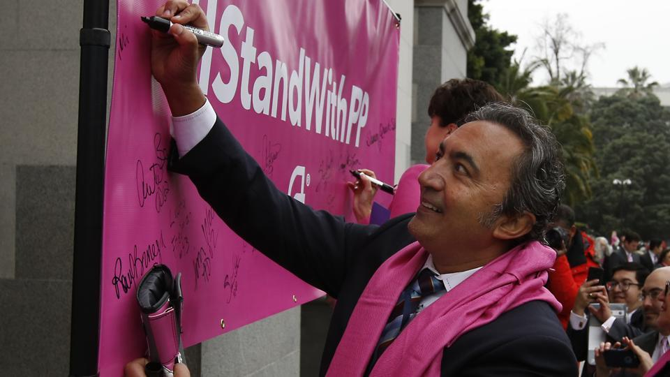 Rep. Ami Bera, D-Calif., signs a banner supporting Planned Parenthood at the Capitol Pink Out Day 2017 rally on January 17.