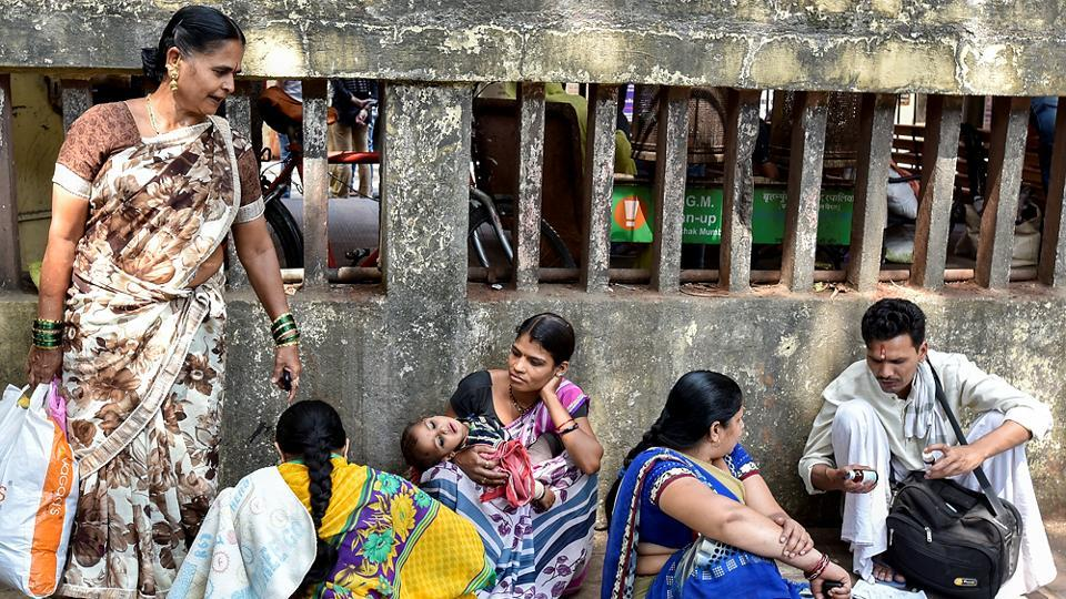 Patients sit outside Mumbai's Sion hospital after being refused admission on account of the ongoing doctors' strike in Maharashtra.