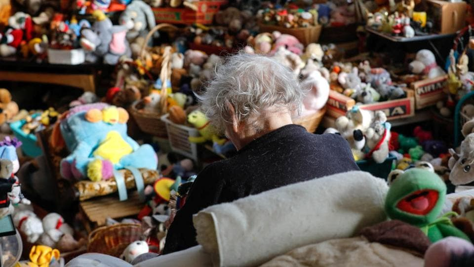 Belgian Catherine Bloemen,  sits among more than 20,000 stuffed and plastic toys. (Yves Herman / Reuters)