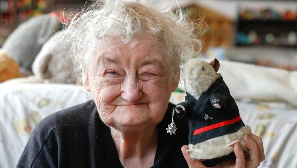 Belgian Catherine Bloemen, 86, poses with her favourite stuffed animal among a collection of more than 20,000 pieces she is collecting for more than 65 years. (Yves Herman / Reuters)