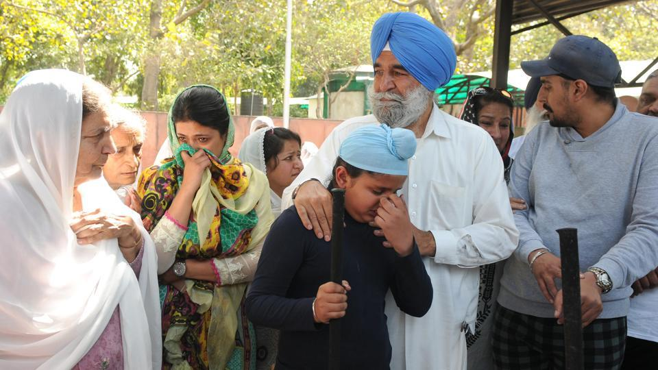 Ekam Singh Dhillon's family members during the cremation of his body at the Sector-­25 crematorium in Chandigarh on Tuesday.