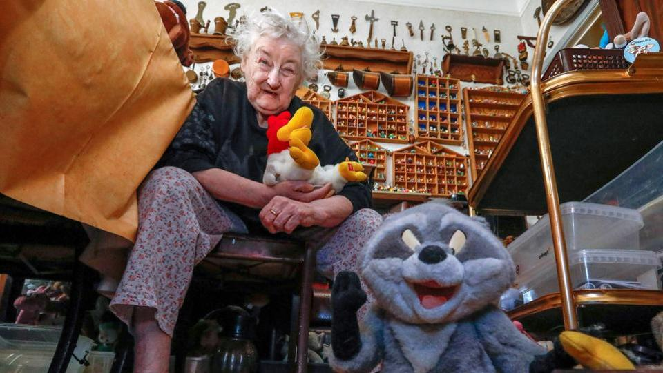 Bloemen's ,poses with her ' singing rooster'. (Yves Herman / Reuters)
