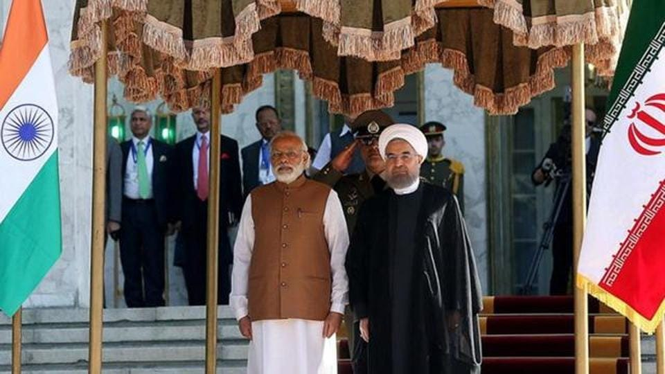 TIran's President Hassan Rouhani (R) stands next to Prime Minister Narendra Modi during an official welcoming ceremony in Tehran, Iran.