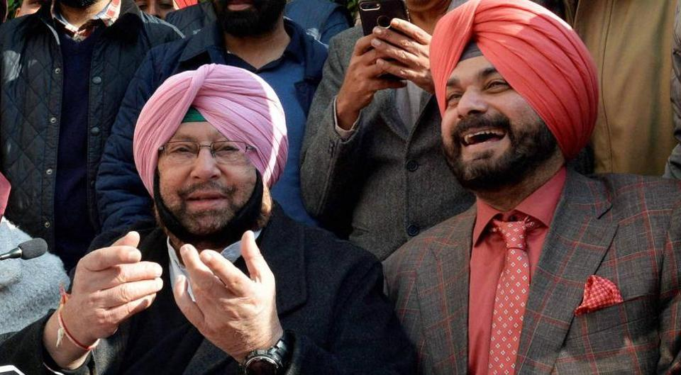 Punjab chief minister Capt Amarinder Singh with Navjot Singh Sidhu during a press conference in Amritsar.
