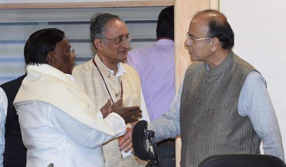 Finance minister Arun Jaitley talks to West Bengal Finance Minister Amit Mitra and Puducherry CM V Narayanasami at a GST Council Meeting, at Vigyan Bhawan in New Delhi.