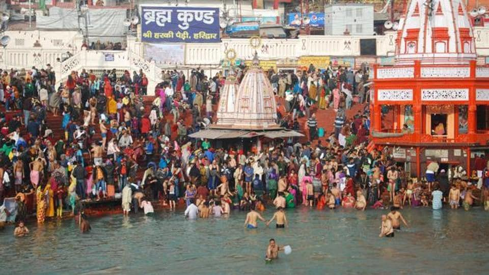 Devotees take a dip in Ganga on the first day of Ardh Kumbh fair, Haridwar, January 14, 2016