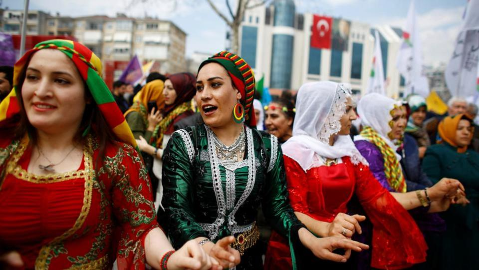 People gesture during a gathering celebrating Newroz, which marks the arrival of spring and the new year, in Istanbul, Turkey. (Osman Orsal/REUTERS)