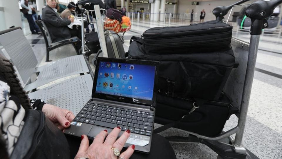 A woman checks her laptop at the Beirut international airport. The US and the UKhave banned laptops and other devices on flights from some countries.
