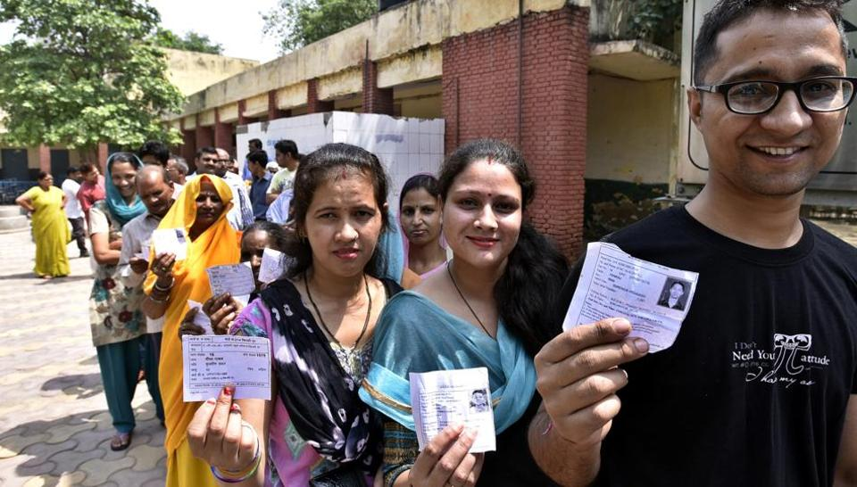 People queue up to cast their votes in the Delhi municipal bypolls in east Delhi on May15, 2016.
