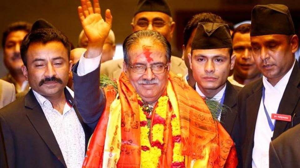 """File photo of Nepal Prime Minister Pushpa Kamal Dahal """"Prachanda"""" waving to the media after he was elected the 24th premier in 26 years in August 2016."""
