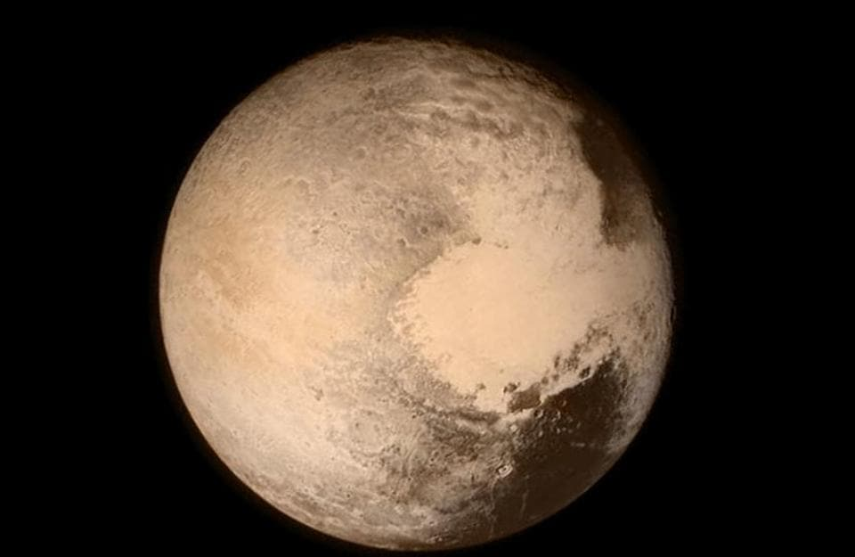 Pluto nearly fills the frame in this image from the Long Range Reconnaissance Imager (LORRI) aboard NASA's New Horizons spacecraft, taken on July 13, 2015 when the spacecraft was 476,000 miles (768,000 kilometers) from the surface.