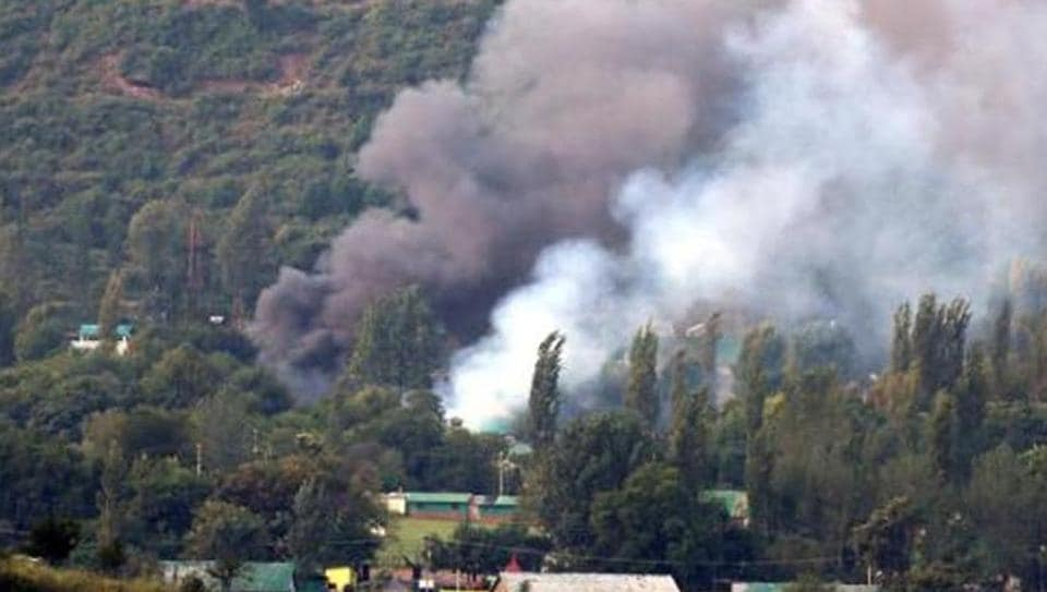 Smoke rises from the army base attacked by militants in the town of Uri, west of Srinagar on September 18. The NIA's conclusion that the LeT carried out the Uri attack is based on the coded matrix sheets recovered from the neutralised attackers.