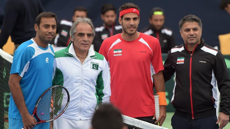 Aqeel Khan (L) and team coach Rashid Ahmad Malik (2L) of Pakistan, and Shahin Khaledan (2R) and team captain Saeed Ahmadvand (R) of Iran pose for a photograph ahead of their Davis Cup tennis group II match at the Sports Complex in Islamabad on February 3, 2017.  The International Tennis Federation announced on Tuesday that Hong Kong had withdrawn from their Davis Cup tiein Pakistan citing security concerns.