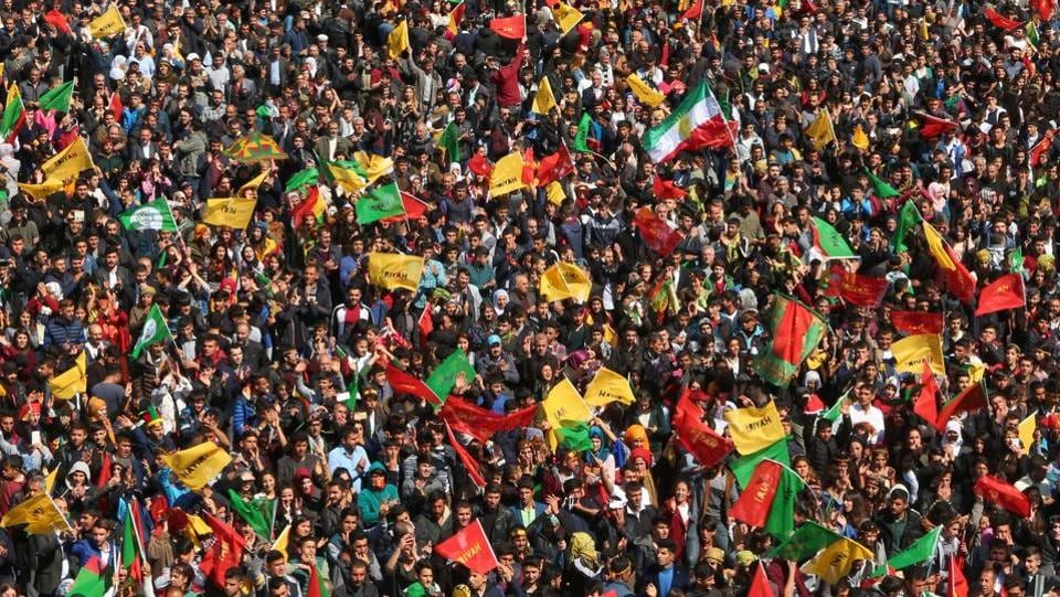 Turkish Kurds gather to celebrate Newroz at Diyarbakir. In a sign of the tensions, police opened fire on a man carrying a knife and a rucksack who did not  obey a request to have his bag searched as he entered the designated area and shouted he was carrying a bomb. (Ilyas Akengin/AFP)