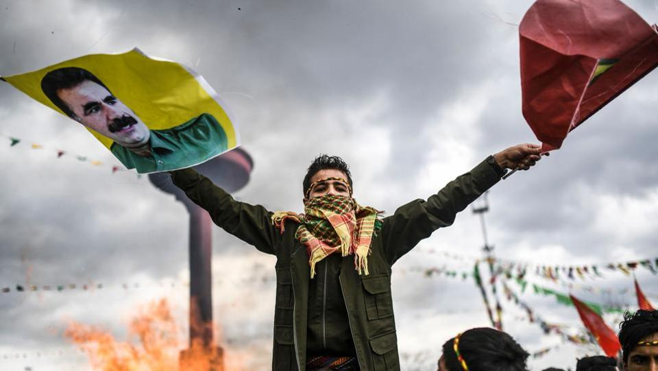A Kurdish boy waves flags with a picture of jailed Kurdish leader Abdullah Ocalan during the celebrations of Newroz. (Bulent Kilic/AFP)