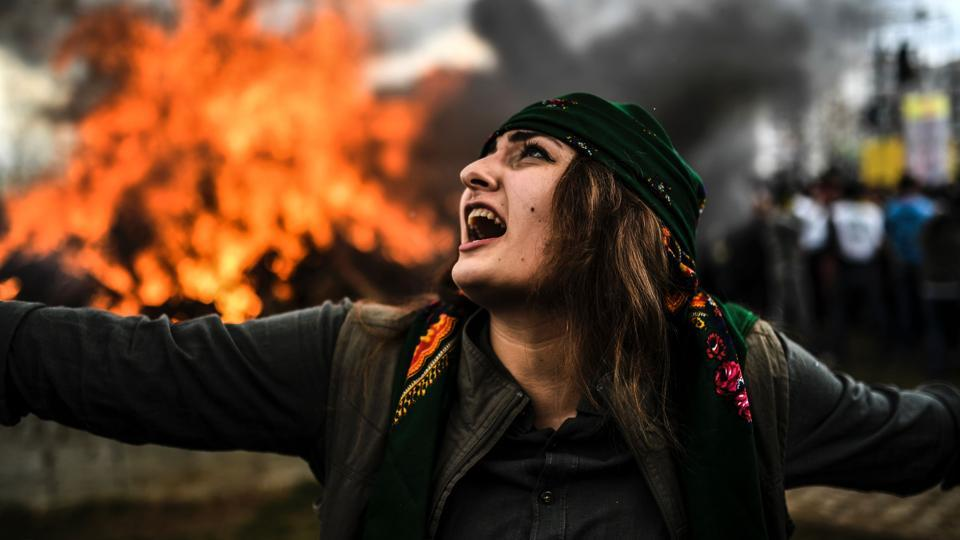 A Kurdish woman dances in front of a fire as Turkish Kurds gather for Newroz celebrations for the new year in Diyarbakir, southeastern Turkey. Newroz (also known as Nawroz or Nowruz) is an ancient Persian festival, which is also celebrated by Kurdish people, marking the first day of spring. (Bulent Kilic/AFP)
