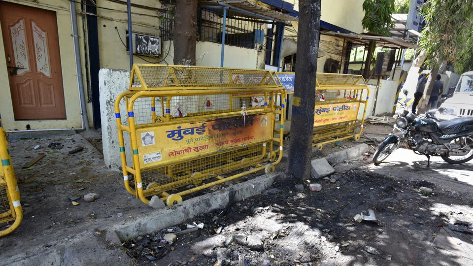 An agitated mob torched a vehicle at the Trombay police station on Monday.