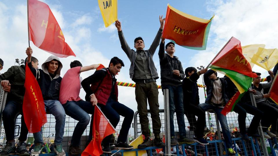 Turkish Kurds wave flags with the lettering 'No' in Turkish and Kurdish. We will continue with our struggle for peace, never giving up our quest for freedom through democratic politics, the jailed co-chairs Selahattin Demirtas and Figen Yuksekdag said in a statement issued by the HDP. (Ilyas Akengin/AFP)