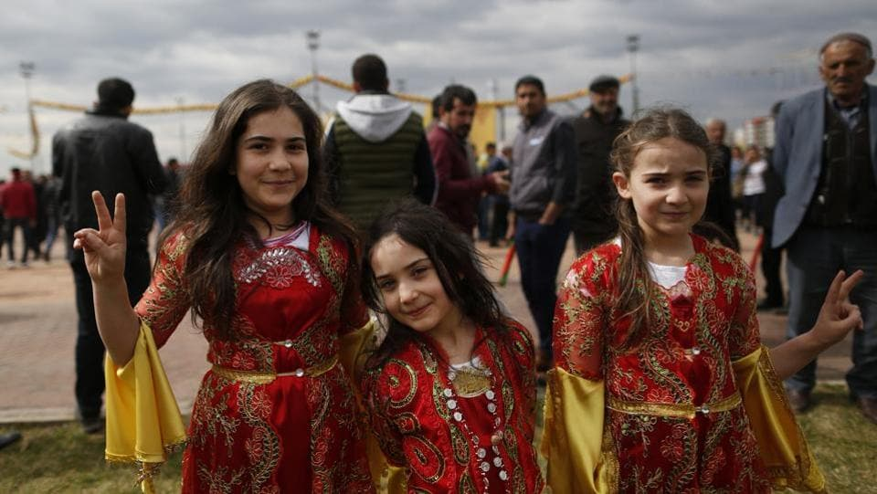 Children in traditional Kurdish clothing, pose for the photographer during the Newroz celebration, in Diyarbakir, southeastern Turkey. Thousands celebrated the Newroz festival in Istanbul and in Diyarbakir, a mainly Kurdish city in a region where Kurdish militants regularly clash with government forces. In Turkey, the spring festival traditionally serves as an occasion to demand more rights for the Kurdish minority. (Lefteris Pitarakis/AP)