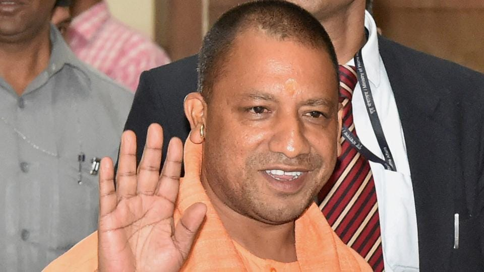 Uttar Pradesh chief minister Yogi Adityanath arrives for a meeting with police officers at Lok Bhawan in Lucknow.