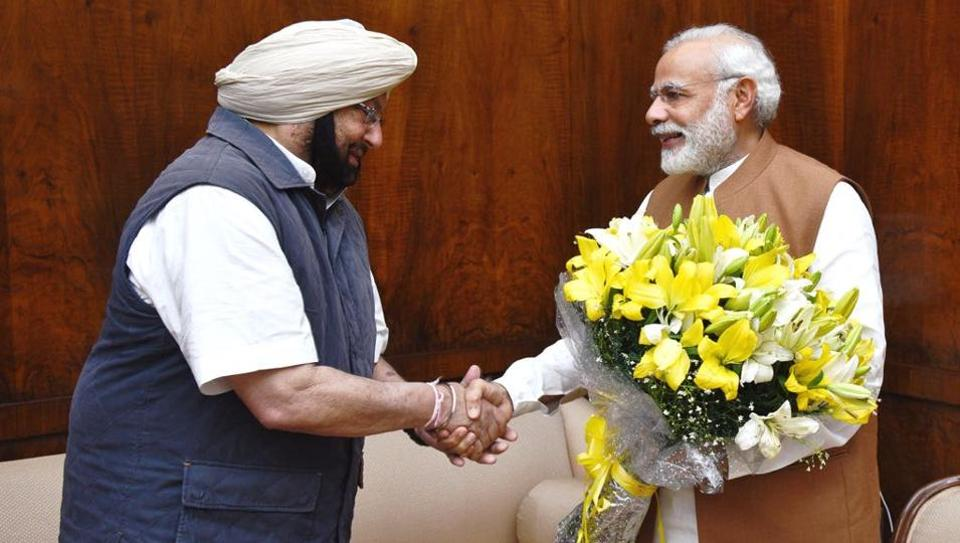 Punjab chief minister Amarinder Singh with PM Narendra Modi in New Delhi on Wednesday.