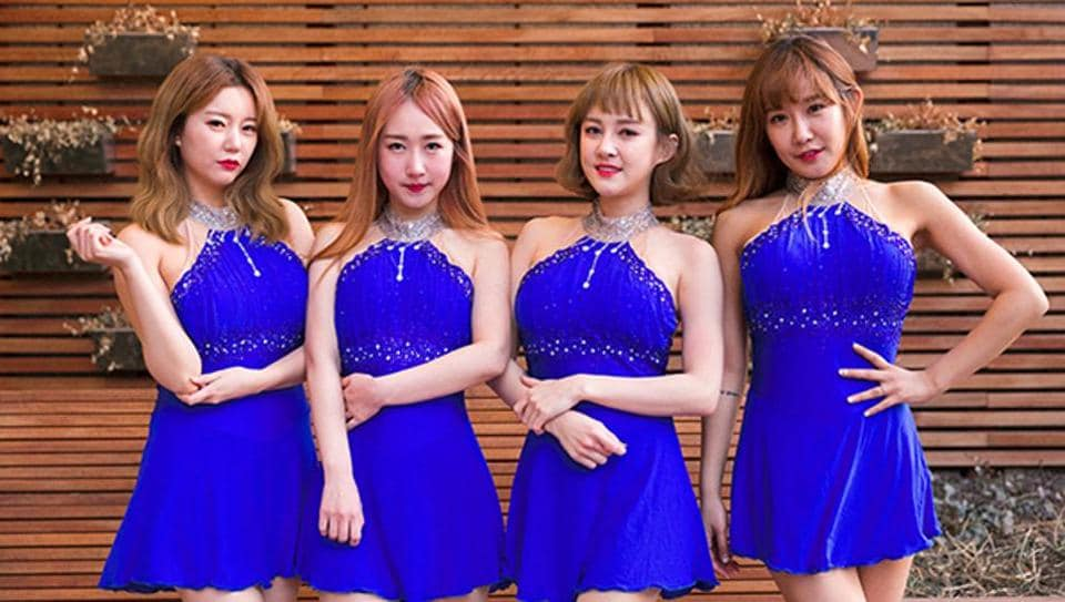 K-pop group SixBomb members posing for a photo during an interview with AFP in Seoul.