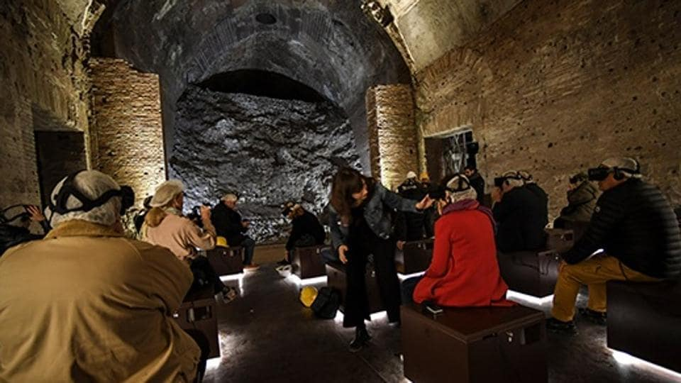 Visitors wear special 3D viewing devices in a room of the Domus Aurea, a large palace built by the Roman Emperor Nero in the first century.