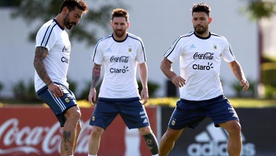 Argentina's Ezequiel Lavezzi (left) kicks the ball next to Sergio Aguero and Lionel Messi during a training session ahead of their 2018 FIFAWorld Cup qualifier against Chile
