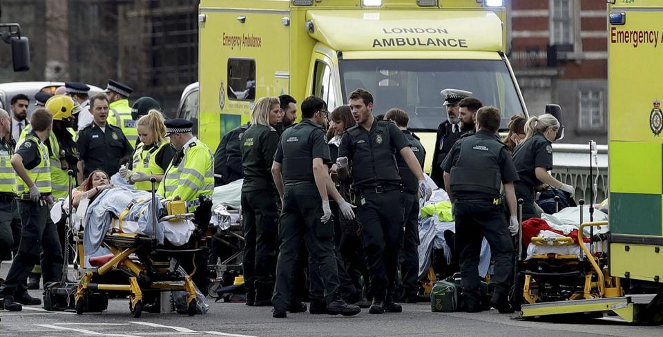 Emergency services staff provide medical attention close to the Houses of Parliament in London, Wednesday, March 22, 2017.  (AP)