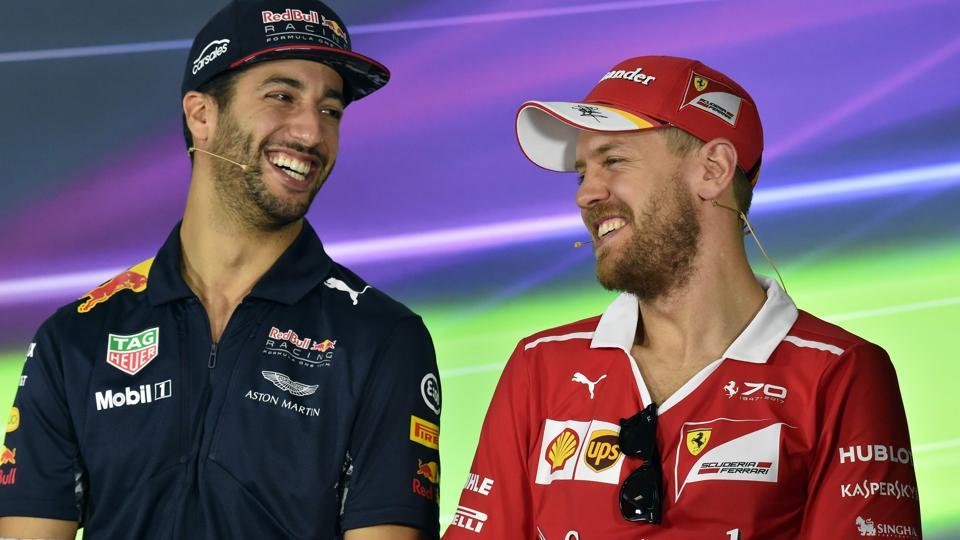 Ferrari Formula One team's German driver Sebastian Vettel (right) and Red Bull's Australian driver Daniel Ricciardo shares a light moment during the press interaction on Thursday, ahead of the Australian Grand Prix in Melbourne . (AFP)