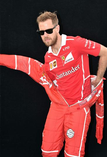 Ferrari's German driver Sebastian Vettel caught in a last-minute wardrobe change during the photoshoot in Melbourne on Thursday. (AFP)