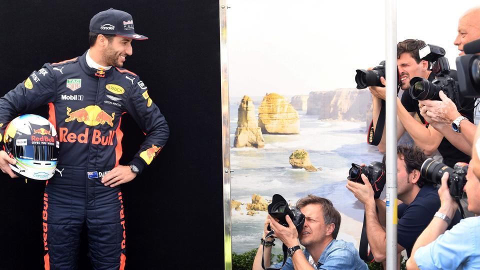 Red Bull F1 team's Australian driver Daniel Ricciardo (L) had some fun with the shutterbugs during the official photoshoot in Melbourne. The local driver would be hoping to have a great start to the season at the Australian Grand Prix this weekend.  (AFP)