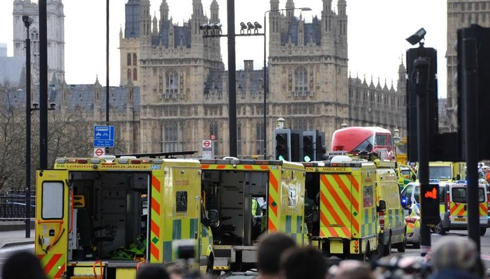 Ambulances wait as members of the emergency services work on Westminster Bridge, alongside the Houses of Parliament in central London on March 22, 2017, during an emergency incident.