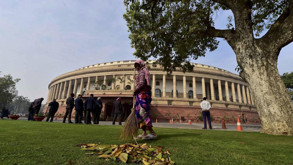 A sweeper works at Parliament during the budget session in New Delhi.