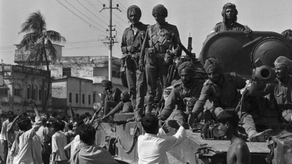 Indian soldiers helping East Pakistan citizens during the 1971 Bangladesh Liberation War.