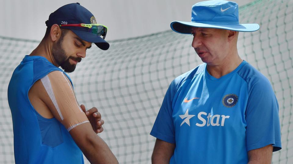 India's skipper Virat Kohli with team physiotherapist Patrick Farhart during a practice session. (PTI)